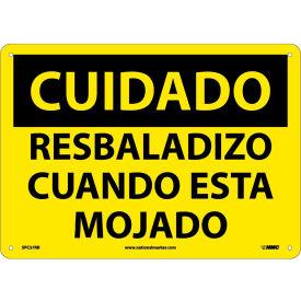 Spanish Plastic Sign - Cuidado Resbaladizo Cuando Esta Mojado